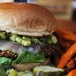 Quinoa burger with avocado-corn relish and sweet potato fries - Lazlo's Brewery & Grill.