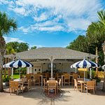 Stop by The Pool House and enjoy a full meal or light bite to eat, cold drinks, and a pretty vie