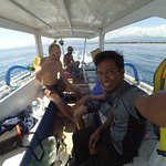 Me shaving on the snorkeling trip around the main Gilis. Rivaan is taking the photo.