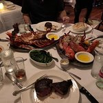 A perfect table for 4 with 4 steaks and two 3 pound lobsters