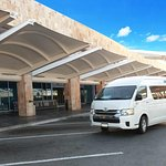 MeetPlaya transportation van at Cancun Airport