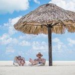Passion Island grass umbrella & beach loungers