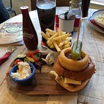This is a Guest Burger. Chicken, bacon and mature cheddar. Served with coleslaw, salad and chips