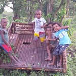 The young Fijian children are excited to have visitors to their village
