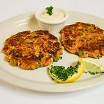 Crab Cakes:blue crab claw meat mixed w/ roasted corn, red bell peppers, & fresh bread crumbs