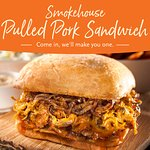 Our famous smoked pulled pork piled high in a sweet bun w/ sautéed onions, mayo honey gold BBQ s