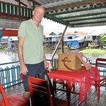 Enjoy a picnic lunch on the deck of a stilt home at Kompong Phluk near SR