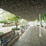 A seating area that doubles as the walkway that contains all those tourist names on their own le