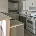 Fully equipped kitchen and in-unit washer and dryer