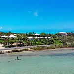 Paddleboard fisherman looking for bonefish in the lake by Harbour Club Villas