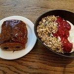 Chocolate croissant along with yogurt and homemade granola