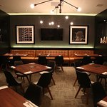 Our private dining room is fully equipped with A/V, three large screen TVs, and can seat up to 4