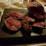 Filet Mignon cooked on a stone grill on your table. Stone is 700 degree hot!!!