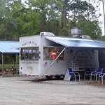 The kitchen, with an open air covered picnic table shelter behind it