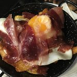 Cured ham with french fries and egg.