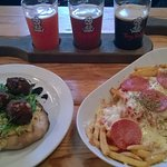 Falafel flatbread, dirty pizza fries and a flight of craft beer