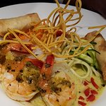 Dinner feature. Green curry on rice noodles with spicy prawns, mango spring rolls