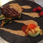 Beef steak with estragon , potatoes au graten and grilled vegetables.