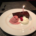 chocolate cake with raspberry ice cream and whipped cream
