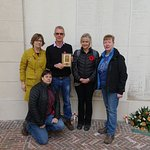 The family, gathered in remembrance at Panel 4, Ploegsteert Memorial