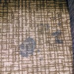 nasty sticky stain between beds - carpets dirty