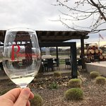 Raising a glass of Sauvignon Blanc at the patio at Provenance Vineyards in Rutherford.
