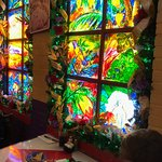 Stained or painted glass.  Nice atmosphere