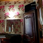 You can see the beautiful wallpaper and beamed ceilings.