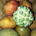 Here we have some fruits such as grafted mangoes and sugar apple.