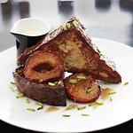 Brioche French toast, slow-roast peach and pistachios