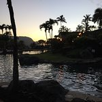 Looking out from pool to the sunset over Hanalei Bay