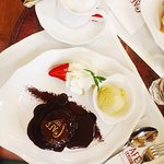 Warm chocolate cake with a gold Cafe Central logo is a must for Instagrammers!