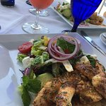 Their famous Blackened Lion Fish over Greek Salad - our favorite!!