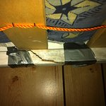 Damaged top bunk held together with gaff tape!
