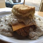 Biscuit with gravy, fried chicken, and cheddar