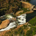 Drone coverage overlooking the dam ,one of the sluice gates open