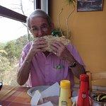 My husband enjoying his Pork Pitta Bread