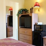 Queen room with refrigerator, microwave, cable, AC, coffee maker