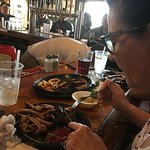 Digging into the split of a full rack of ribs with Hubby.