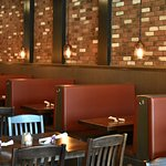 Cozy, casual dining room with booths, tables, and full bar