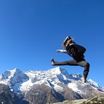 Happiness Jump from Khumjung, with Kongde Mountain in the background. Everest Region