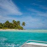 Leaving one foot island on the Aitutaki Lagoon