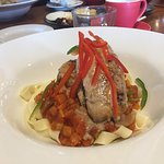 Truffle-infused Chicken in a bed of pasta with Spanish Tomato Sauce