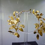 Golden wreath - represents the deceased in his newly acquired position of immortal hero