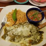 Chile Relleno stuffed with Chicken covered in a Verde Sauce, Beans and Rice.