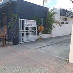 Suites Colonial Parking entrance next to Al Pie de Carbon on Calle 3