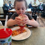 Grand daughter eating her pizza