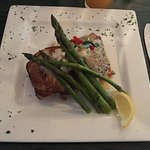 Flounder over mushroom risotto with crab meat and asparagus