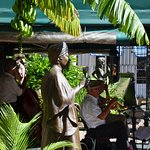 Bourbon Street Cafe with statues of New Orleans Musical Legends