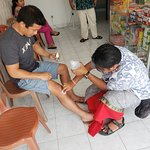 agus stopped at a pharmacy and helped dress our wounds from a motorbike accident two days before
